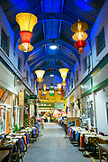 The colourful Brixton Village on 13th February 2015 in London, United Kingdom. The multi-cultural Brixton Village hosts a number of small independant restaurants, cafes and shops in the London Borough of Lambeth.