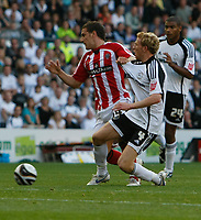Photo: Steve Bond/Richard Lane Photography. Derby County v Sheffield United. Coca-Cola Championship. 13/09/2008. Billy Sharp (L) grapples with Paul Green (R)