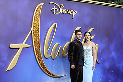 Naomi Scott and Mena Massoud arrive at the UK premiere of Aladdin in London's Leicester Square.<br /><br />9 May 2019.<br /><br />Please byline: Vantagenews.com