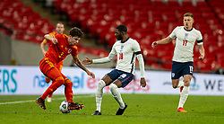 LONDON, ENGLAND - Thursday, October 8, 2020: Wales' Neco Williams (L) and England's Ainsley Maitland-Niles during the International Friendly match between England and Wales at Wembley Stadium. The game was played behind closed doors due to the UK Government's social distancing laws prohibiting supporters from attending events inside stadiums as a result of the Coronavirus Pandemic. England won 3-0. (Pic by David Rawcliffe/Propaganda)