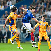 05 September 2009: Romanian defender and captain Cristian Chivu vies with French forward Andre-Pierre Gignac during the World Cup 2010 qualifying football match France vs. Romania (1-1), on September 5, 2009 at the Stade de France stadium in Saint-Denis, near Paris, France.