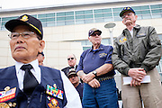 Phil Coney (center) and Art Ebright (right) stand during the play of the Armed Forces Salute during the Memorial Day Ceremony at City Hall in Milpitas, California, on May 25, 2015. (Stan Olszewski/SOSKIphoto)
