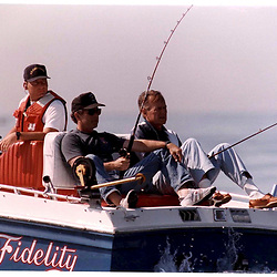 P24252-23     George W. Bush fishing with his father, President George H. Bush, off Kennebunkport, Maine, 13 Aug 91.<br /> Photo Credit:  George Bush Presidential Library