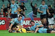 Motu Matu'u dives over to score a try. Waratahs v Hurricanes. 2012 Super Rugby round 15 match. Allianz Stadium, Sydney Australia on Saturday 2 June 2012. Photo: Clay Cross / photosport.co.nz