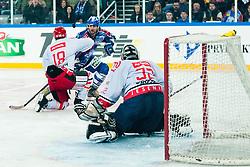 Frank Banham (KHL Medvescak Zagreb, #38) vs Marjan Manfreda (HK Acroni Jesenice, #18) during ice-hockey match between KHL Medvescak Zagreb and HK Acroni Jesenice in 39th Round of EBEL league, on Januar 8, 2012 at Arena Zagreb, Zagreb, Croatia. (Photo By Matic Klansek Velej / Sportida)