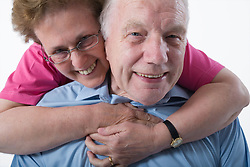 Portrait of an older couple embracing,