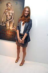 ROSIE HUNTINGTON-WHITELEY at an exhibition of paintings by artist Rene Richard at the Scream Gallery, Bruton Street, London on 3rd April 2008.<br /><br />NON EXCLUSIVE - WORLD RIGHTS