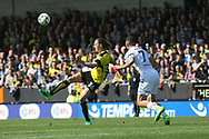 Jackson Irvine under pressure from Kemar Roofe during the EFL Sky Bet Championship match between Burton Albion and Leeds United at the Pirelli Stadium, Burton upon Trent, England on 22 April 2017. Photo by John Potts.