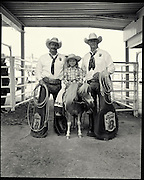 Wade (L) and Gary Remple with Kennedi MacMillan behind the chutes at the rodeo. The Remple brother's are pick up me in the rodeo, rescuing saddle bronc and bareback riders off their bucking horses. They have worked the Stampede for over 25 years and are considered some of the best horsemen in the business. MacMillan, know as the Pick Up Chick, gathers the horses after the wild pony race. Photograph by Todd Korol for The Globe and Mail