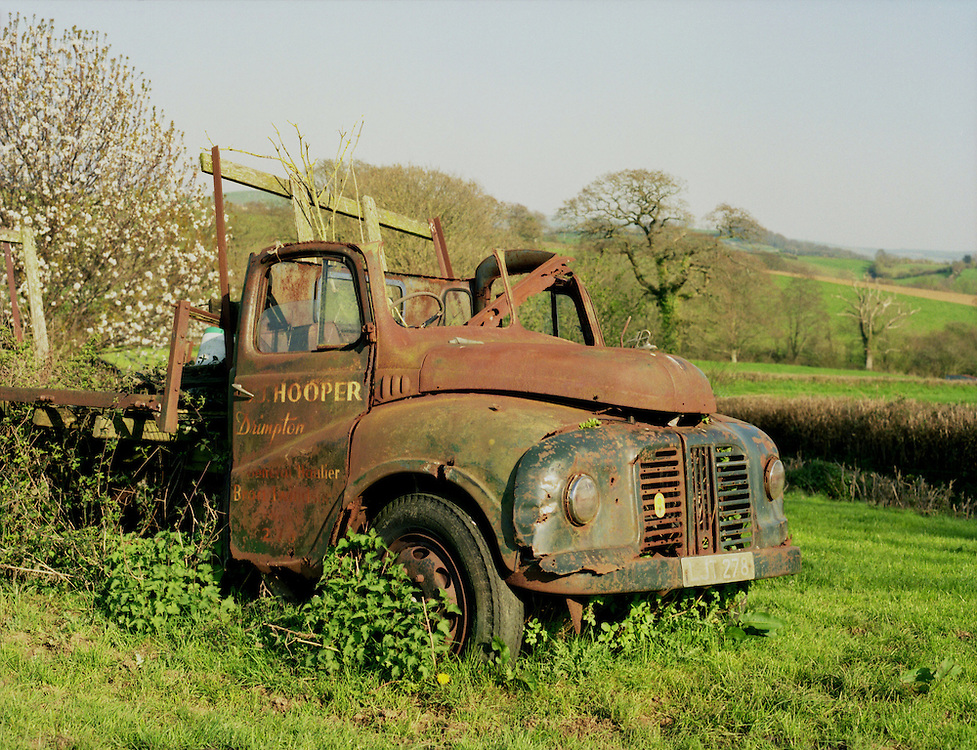 A rusted lorry in a field in Dorset, England.<br /> [This photograph is currently licensed through Millennium Images - please contact the photographer for details]