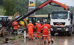02.06.2013, B311, Hoegmoos, AUT, Pinzgau starke Regenfaelle, im Bild Einsatzkraefte der Freiwilligen Feuerwehr beim Murenabgang an der B311 bei Hoegmoos. Die Strasse wurde fuer den Verkehr gesperrt. Starkregen sorgt derzeit vor allem in Tirol, Oberoesterreich und Salzburg für massive Überflutungen, Vermurungen und Hangrutsche // Parts of Pinzgau were declared a disaster area. Heavy rain is currently making, especially in Tyrol, Upper Austria and Salzburg for massive flooding, mudslides and landslides, Hoegmoos, Austria on 2013/06/02. EXPA Pictures © 2012, PhotoCredit: EXPA/ Juergen Feichter