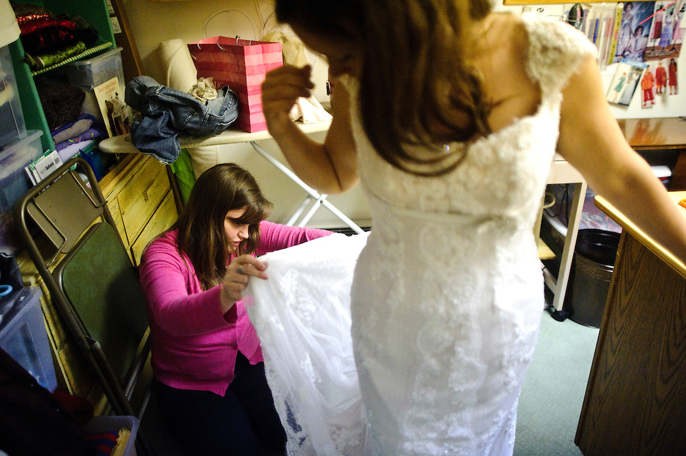(photo by Matt Roth)..Sarah Nix's wedding dress fitting Monday, September 21, 2009.