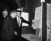 05/01/1965.01/05/1965.5th January 1965.The Aer Lingus Young Scientist Exhibition at the .Manson House,..Oliver Mc Bryan (U.C.D. Mathematical Science student) expLins his prizewinning project to An Taoiseach Sean Lemass and P.J. Lynch Chairman of Aer Lingus. Oliver (who's relatives live in Ardogh, Bantry area) was runner up to the Young Scientist of the year, and was recommended for and additional £50 prize, together with the 2nd prize.
