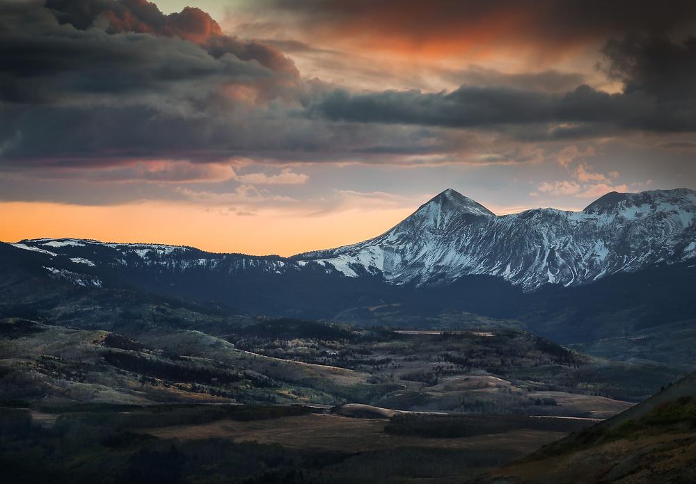 The last light of day shines through a passing storm.  San Juan Mountains, Colorado, USA