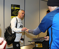 Jose Mourinho of Manchester United is spotted on his way to catch a flight as the team fly to Turin on Tuesday afternoon to play Juventus in The Champions League on Wednesday night.