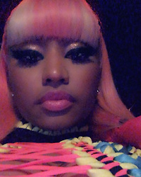"""Nicki Minaj releases a photo on Instagram with the following caption: """"Strawberry shortcake on the hair \ud83c\udf53 Barbie\u2019s back \ud83e\udd84"""". Photo Credit: Instagram *** No USA Distribution *** For Editorial Use Only *** Not to be Published in Books or Photo Books ***  Please note: Fees charged by the agency are for the agency's services only, and do not, nor are they intended to, convey to the user any ownership of Copyright or License in the material. The agency does not claim any ownership including but not limited to Copyright or License in the attached material. By publishing this material you expressly agree to indemnify and to hold the agency and its directors, shareholders and employees harmless from any loss, claims, damages, demands, expenses (including legal fees), or any causes of action or allegation against the agency arising out of or connected in any way with publication of the material."""