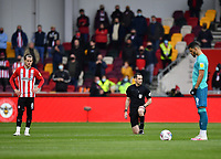 Football - 2020 / 2021 Sky Bet Championship - Semi-final play-offs - Second leg - Brentford vs AFC Bournemouth - Brentford Community Stadium<br /> <br /> Referee Jarred Gillett takes the knee as players from both sides stand.<br /> <br /> COLORSPORT/ASHLEY WESTERN
