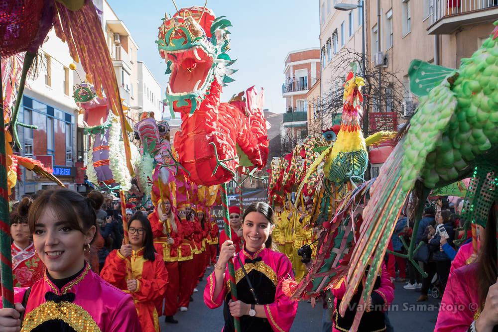 Madrid, Spain. 18th February, 2018. Reveler carrying a red dragon during the Chinese New Year parade in Madrid. © Valentin Sama-Rojo