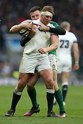 England's Dylan Hartley is held up during the NatWest 6 Nations match at Twickenham Stadium, London.