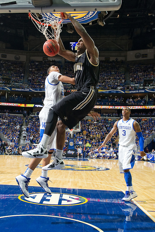 New Orleans , LA. - Game 11 of the 2012 SEC Men's Basketball Tournament between Kentucky and Vanderbilt, was played Monday, March 12, 2012 at the New Orleans Arena. Vanderbilt center Festus Ezeli right, dunks over Kentucky forward Anthony Davis in the second half.