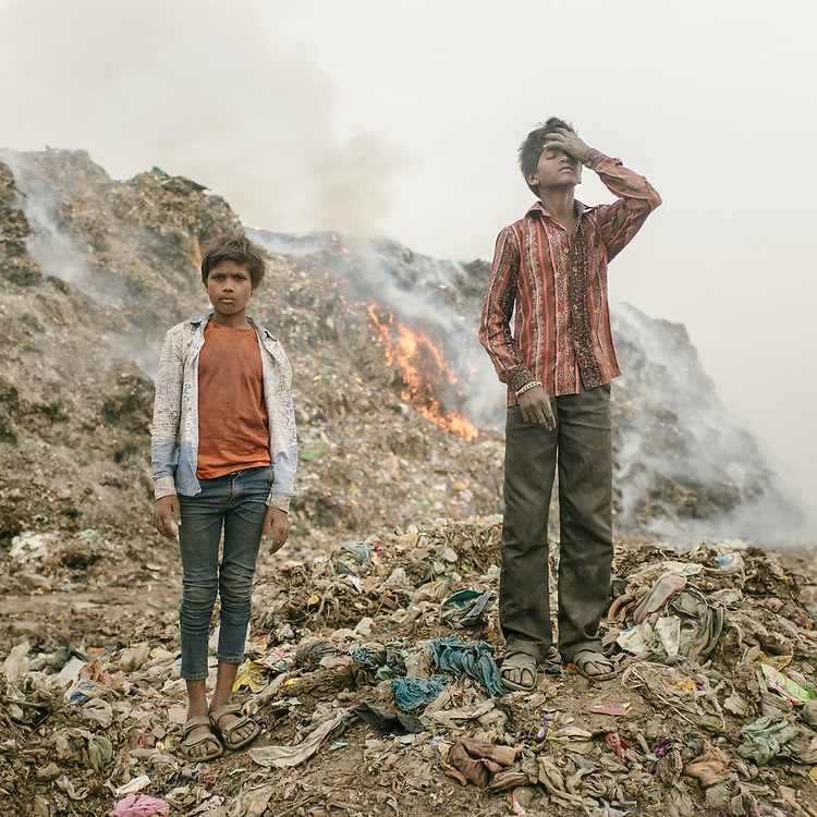 Sonu and Lal, Recyclers in Bhalswa, on top of one of the giant open air garbage dump which burns 24/7, creating toxic fumes.