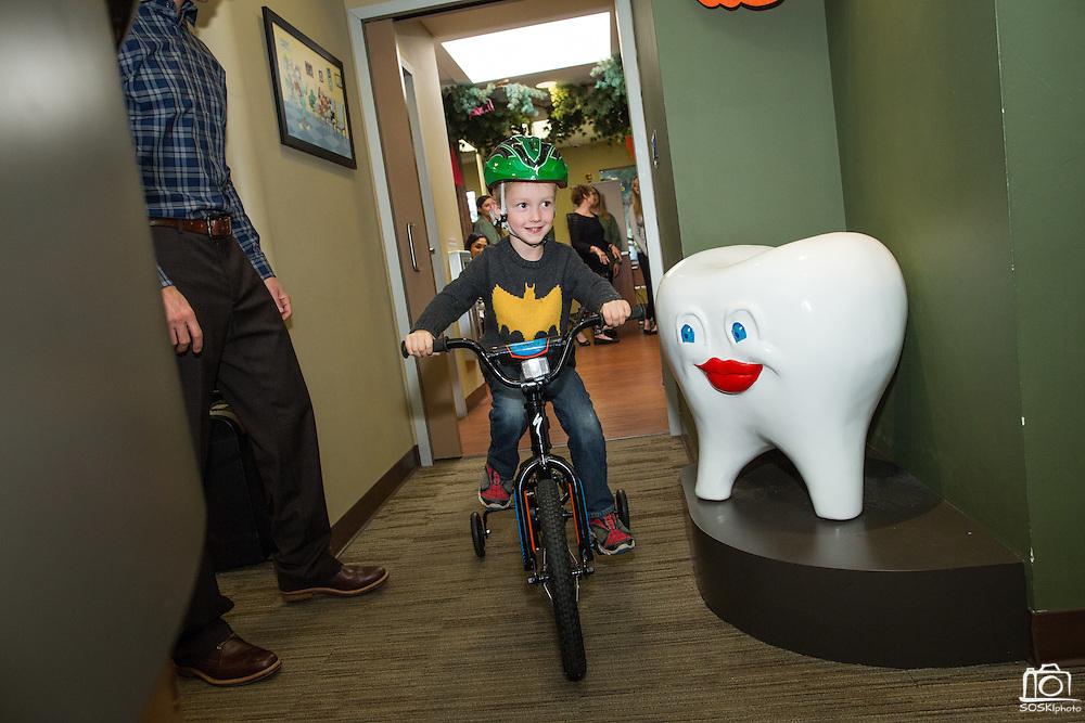 Annual Bicycle No Cavity winner receives his bike at Dr. Rabitz Pediatric Dentistry in San Jose, California, on November 23, 2015. (Stan Olszewski/SOSKIphoto)