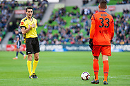 Officials give Perth Glory goalkeeper Liam Reddy (33) a warning at the Hyundai A-League Round 2 soccer match between Melbourne Victory and Perth Glory at AAMI Park in Melbourne.