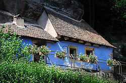Troglodyte dwelling in the village of Graufthal, Alsace, France.  The houses are built into the cliffs with the rock forming the ceiling and floor.  Dating back several centuries, the houses were inhabited until 1958 and are now a historical monument.<br /> <br /> (c) Andrew Wilson   Edinburgh Elite media