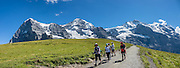"Walk downhill from Eigergletscher train station (of the Jungfraujoch ""Top of Europe"" railway) under the north face of the Eiger (3970m / 13,020 ft elevation) to Alpiglen station in Grindelwald Valley, Canton of Bern, Switzerland, the Alps, Europe. The Eiger has the biggest north face in the Alps: 1800 vertical meters (or 5900 ft) of rock and ice. The Swiss Alps Jungfrau-Aletsch region is honored as a UNESCO World Heritage Site.The Swiss Alps Jungfrau-Aletsch region is honored as a UNESCO World Heritage Site. This image was stitched from multiple overlapping photos. For licensing options, please inquire."