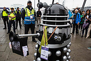 A Stop The Arms Fair activist operating a model Dalek tries to gain access to ExCeL London on the first day of the DSEI 2021 arms fair on 14th September 2021 in London, United Kingdom. Activists from a range of different groups have been protesting outside the venue for one of the worlds largest arms fairs for over a week.