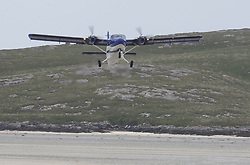 Barra Airport is a short-runway airport situated in the wide shallow bay of Traigh Mhòr at the north tip of the island of Barra in the Outer Hebrides, Scotland. Barra is now the only beach airport anywhere in the world to be used for scheduled airline services. Loganair Twin Otter taking off.(c) Stephen Lawson   Edinburgh Elite media