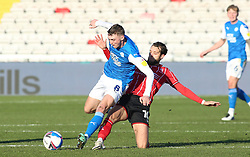 Jack Taylor of Peterborough United is tackled by Jorge Grant of Lincoln City - Mandatory by-line: Joe Dent/JMP - 09/01/2021 - FOOTBALL - LNER Stadium - Lincoln, England - Lincoln City v Peterborough United - Sky Bet League One