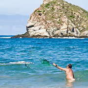 Man fising with a net at Bahia del Palmar (Palmar Bay) Ixtapa, Guerrero, Mexico