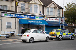 © Licensed to London News Pictures. 27/04/2020. London, UK. A crime scene is in place outside an address on Aldborough Road North in Ilford where two children were stabbed to death and a 40 year old man suffered knife injuries last night . Photo credit: George Cracknell Wright/LNP