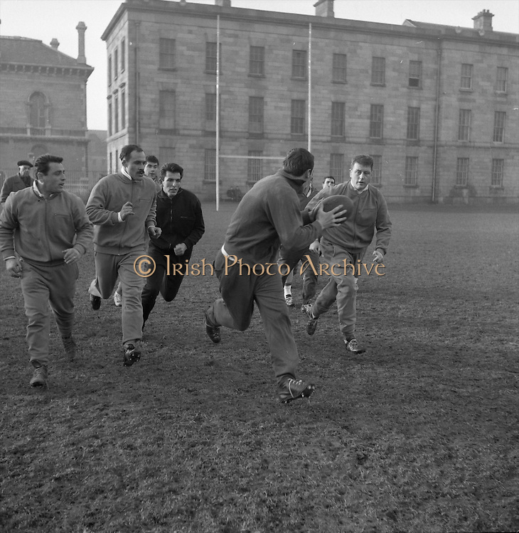 Irish Rugby Football Union, Ireland v France, Five Nations, French Trial, Dublin, Ireland, Friday 25th January, 1963,.25.1.1963, 1.25.1963,..Referee- F G Price, Welsh Rugby Union, ..Score- Ireland 5 - 24 France, ..Irish Team, ..T J Kiernan,  Wearing number 15 Irish jersey, Captain of the Irish team, Full Back, University college Cork Football Club, Cork, Ireland,  ..W R Hunter, Wearing number 14 Irish jersey, Right Wing, C I Y M S Rugby Football Club, Belfast, Northern Ireland, ..A C Pedlow, Wearing number 13 Irish jersey, Right Centre,  C I Y M S Rugby Football Club, Belfast, Northern Ireland, ..A J O'Reilly, Wearing number 12 Irish jersey, Left Centre, Old Belvedere Rugby Football Club, Dublin, Ireland,  ..P J Casey, Wearing number 11 Irish jersey, Left Wing, University College Dublin Rugby Football Club, Dublin, Ireland, ..J B Murray, Wearing number 10 Irish jersey, Stand Off, University College Dublin Rugby Football Club, Dublin, Ireland, ..J C Kelly, Wearing number 9 Irish jersey, Scrum Half, University College Dublin Rugby Football Club, Dublin, Ireland,..P J Dwyer, Wearing number 1 Irish jersey, Forward, University College Dublin Rugby Football Club, Dublin, Ireland, ..A R Dawson, Wearing number 2 Irish jersey, Forward, Wanderers Rugby Football Club, Dublin, Ireland, ..S Millar, Wearing number 3 Irish jersey, Forward, Ballymena Rugby Football Club, Antrim, Northern Ireland,..W A Mulcahy, Wearing number 4 Irish jersey, Forward, Bective Rangers Rugby Football Club, Dublin, Ireland,  ..W J McBride, Wearing number 5 Irish jersey, Forward, Ballymena Rugby Football Club, Antrim, Northern Ireland,..M D Kiely, Wearing number 6 Irish jersey, Forward, Landsdowne Rugby Football Club, Dublin, Ireland, ..C J Dick, Wearing number 8 Irish jersey, Forward, Ballymena Rugby Football Club, Antrim, Northern Ireland,..P J A O' Sullivan, Wearing  Number 7 Irish jersey, Forward, Galwegians Rugby Football Club, Galway, Ireland,..French Team, ..J P Razat, Wearing number 15 French jer