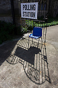 A blue bucket seat and sign that directs voters to the Christchurch United Reform Church, East Dulwich that serves as a temporary Polling station for voters on Britain's general election day.