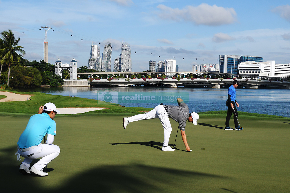SINGAPORE, Jan. 17, 2019  Thailand's player Jazz Janewattananond (L), Japan's player Ryo Ishikawa (C) and Spain's player Sergio Garcia compete during the first day of competition at the SMBC Singapore Open held in Singapore's Sentosa Golf Club on Jan 17, 2019. (Credit Image: © Then Chih Wey/Xinhua via ZUMA Wire)