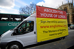 © Licensed to London News Pictures.07/03/2017.London, UK. A van carrying an advertisement, calling for the abolition of the House Of Lords, drives past Parliament, on the day of a vote in the Lord's on the third reading of the Brexit bill. .Photo credit: Ben Cawthra/LNP