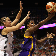 Jantel Lavender, (right), Los Angelses Sparks, shoots past Kayla Pedersen, Connecticut Sun, during the Connecticut Sun Vs Los Angeles Sparks WNBA regular season game at Mohegan Sun Arena, Uncasville, Connecticut, USA. 3rd July 2014. Photo Tim Clayton