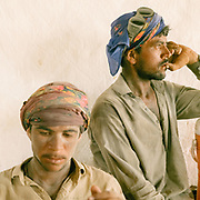 Brick makers take a break from work in 52 degrees heat.