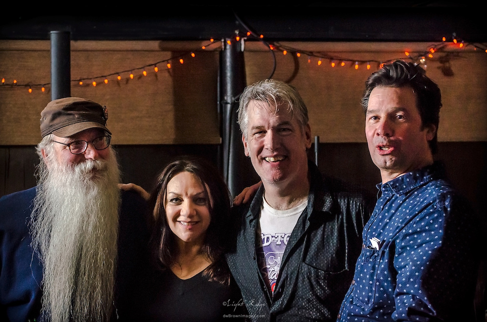 Scott  McClatchy with Vic Martinson (left), the owner of The Bus Stop Music Cafe, and Jake & Yvonne who were instrumental in bringing Scott to the venue.