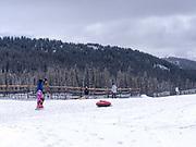 Snow tubing at Keystone Ski Resort, Keystone, Colorado, USA.