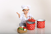 Baby chef with red pots