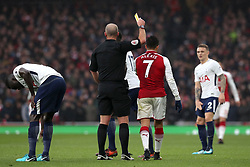 Arsenal's Alexis Sanchez is shown a yellow card during the Premier League match at the Emirates Stadium, London.