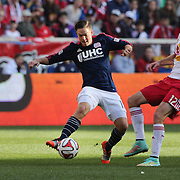 Kelyn Rowe, (left), New England Revolution, is challenged by Eric Alexander, New York Red Bulls, during the New York Red Bulls Vs New England Revolution, MLS Eastern Conference Final, first leg at Red Bull Arena, Harrison, New Jersey. USA. 23rd November 2014. Photo Tim Clayton