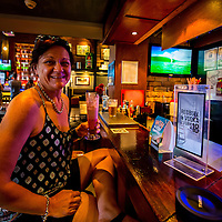 Lori at the bar of the Rattle and Hum bar on the main tourist strip in Cairns.