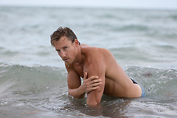 shirtless hunk in the ocean