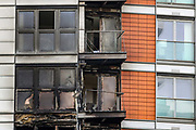 """London, Britain, May 7, 2021 — Parts of the """"New Providence Wharf"""" building is seen in ashed smoke after firefighters tackled a blaze in a 19-storey block of flats in east London on Friday, May 7, 2021. (Photo/ Vudi Xhymshiti)"""