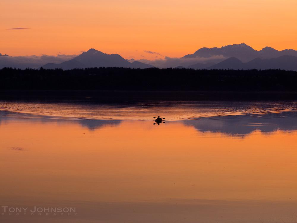 Kayak on Manzanita Bay, Bainbridge Island, WA with the Olympic Mountains