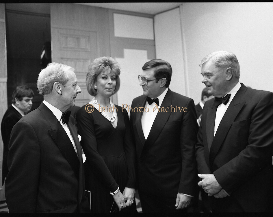 People Of The Year Awards.  (R91)..1988..22.11.1988..11.22.1988..22nd November 1988..This is the fourteenth year of the People of the Year Awards, sponsored by the New Ireland Assurance Company plc. The awards will be presented by Mr Ray Burke TD, Minister of Energy and Communications. Eight people have been nominated this year..Mr Ollie Jennings, for his contribution to community and cultural life of Galway City..Mr Jack Charlton, for restoration of pride to the Irish Soccer team..Ms Carmencita Hederman, For her efforts to instill a community spirit in Dublin..Maureen O'Mahony, for her dedication in assisting the sick and elderly in the Bantry area..Mr Tommy Boyle, for his contribution in having the Garda band ranked as one of the top bands in the world..Ms Alice Leahy, for a lifetime commitment in providing medical care to the Dublin Homeless..Ms Norma Smurfitt, for her voluntary contribution to the work of the Arthritis Foundation Of ireland..Mr Gordon Wilson, for his commitment to peace and reconcilliation in Northern Ireland...Mr Joe Treacy, Chairman, Rehab Irl, Ms Norma Smurfit, Mr Ray Burke TD, Minister for Energy and Communications and Mr Eoin Ryan, Chairman, New Ireland are pictured at the awards ceremony.